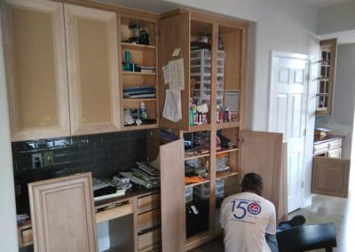 An Image of a Man Refinishing Kitchen Cabinet Doors