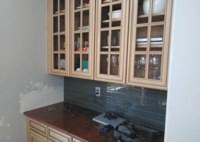 An image of refinished kitchen cabinet doors and drawers