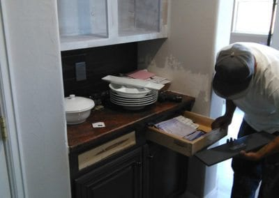 A man working on a drawer front