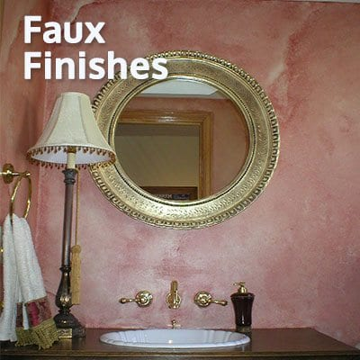 An image of a vanity sink and mirror with a lamp depicting a Faux Finishes Service