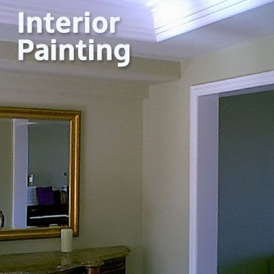 An image of crown molding, wall and door frame depicting an Interior Painting Service